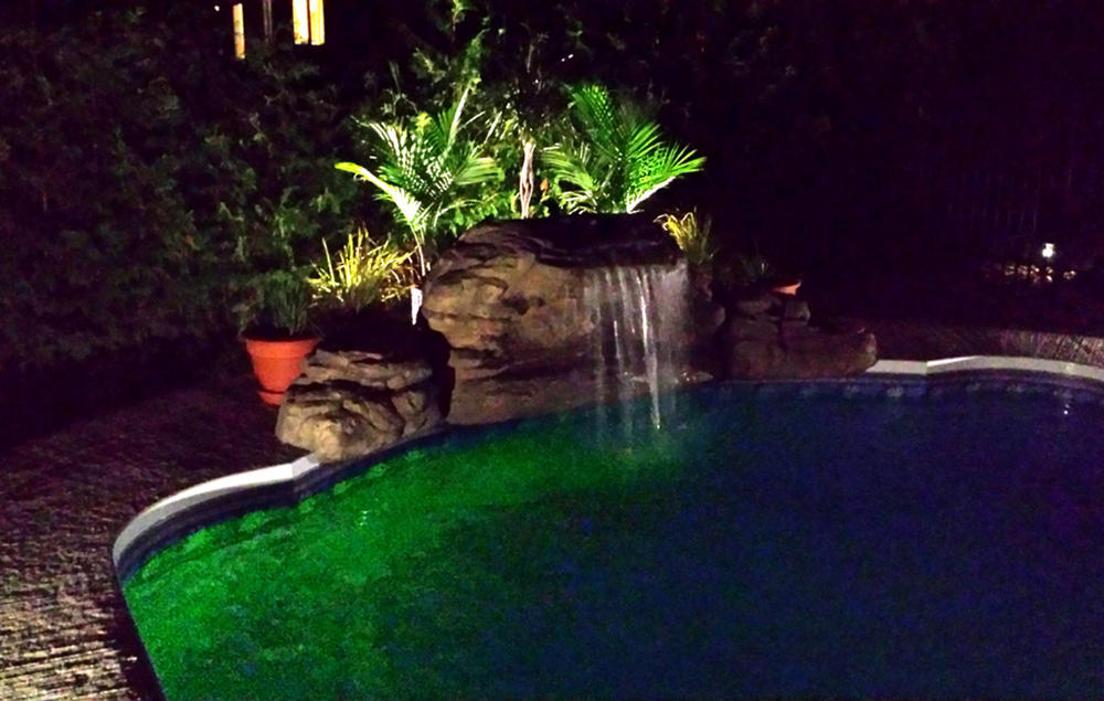 The Oasis waterfall at night